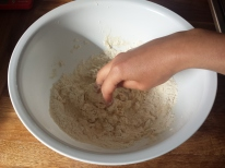 Stirring flour and water together